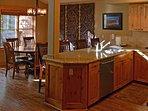 Alderwood cabinetry and wood tile flooring.