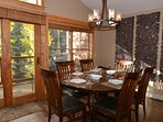 Bright dining room with large table seating for 6.  High chair provided.