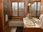Master ensuite bath with separate tub / shower, toilet room and double sink