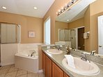 Master bathroom with jet tub and walk-in shower