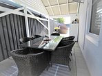 Covered dining area with extra drinks fridge and BBQ