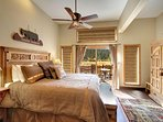 Master bedroom with large doors to the lake and patio