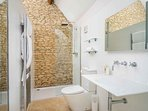 The large ensuite contains a walk-in shower, toilet and basin