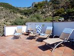 Spacious panoramic roof terrace, complete with great sunloungers, awning and hot/cold shower