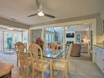 The dining area flows seamlessly into the living area, kitchen & sunroom.