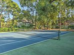 Bring your tennis racquets to challenge your travel companions on the court!