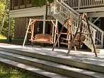 Backyard patio deck with swings and dining furniture