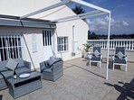 Master terrace with sun lounger's and sofa with chair's.