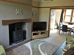 Living room with double sofa bed, open log fire, large TV(house Netflix account),DVD player, DVDs