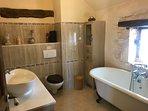 master bedroom ensuite with roll top bath, bidet, toilet, basin