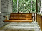 The large front porch boasts a delightful swing chair!