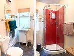 Shower Room. We provide fluffy towels and shower gel.