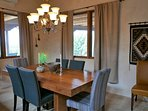 This gorgeous teak table adjoins the kitchen. The chairs are also new!