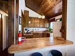 Kitchen with lots of wood detail gives the home that warm cabin