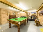 Large games room is found in basement garage