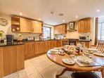 Kitchen diner with bespoke oak cabinets & granite worktop.