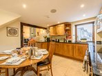 Open plan kitchen diner to lounge with breakfast bar. Dishwasher & washing machine