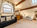 Spacious bedroom with high timbered ceilings. Lovely light & airy