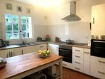 Newly renovated kitchen with dishwasher, two fridges and two ovens