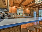Have a seat at the breakfast bar to keep the chef company.