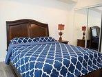 Queen bed and full mirror closet doors