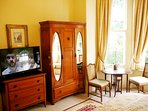 Antique furniture alongside modern facilities.