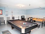 Games room with professional pool table, foosball, and Nintendo 64