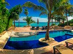 45 foot infinity pool w/palm tree island, sunken jacuzzi seating, sunken chaise