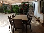 Shady dining area:retractable awning, pool view, next to summer kitchen all for your exclusive use.