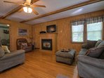 Warm comfortable interior with sleeper sofa, flat TVs and fireplace