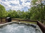 Modern hot tub, with lots of jets and bubbles, overlooking the lawn and river