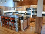 Huge beautiful main kitchen with two ovens, gas cooktop and two dishwashers