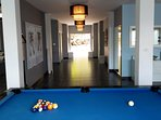 Hall entrance and billiards game.