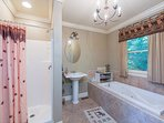 Master bathroom with walk-in shower and jacuzzi tub.