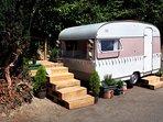 Jemima, our lovely little vintage caravan with her very own secret garden