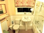 Bathroom with Shower, Fan Heater, Shaving Mirror and Socket