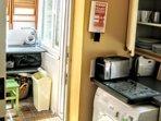 Kitchen into Utility Storage Room, Door to Courtyard