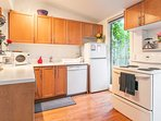 Kitchen has dishwasher, stove, microwave, coffeemaker, toaster and more