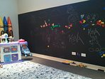 HUGE indoor chalk board in the play-room for the kids to enjoy