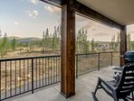 Rocking chair seating, gas grill, and mountain views