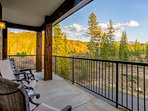 Large wrap around deck looking out to the river and forest