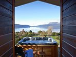 Spa with a view looking out over Lake Tarawera and the volcana beyond.