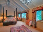Bedroom 1 with four poster and views of bush, lake and mountain