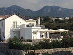 Villa Guzel Manzara (Beautiful View) with mountains to the rear and the Med' in front.