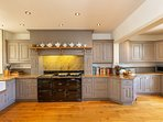 An electric Aga is the heart of the kitchen and the home. We leave instructions and Aga cookbooks.