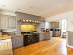 The large bespoke hand-painted kitchen is well equipped with plenty of storage too.