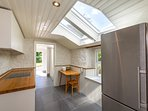The kitchenette offers a second fridge freezer, induction hob & electric oven as alternative to Aga.