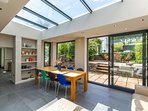The new conservatory has sliding doors which open onto the sheltered courtyard area.