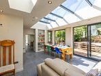 The conservatory leads into the kitchenette and utility room.