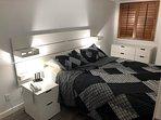 Updated bedroom with queen bed
